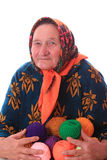 The elderly woman with colour woollen balls Royalty Free Stock Images