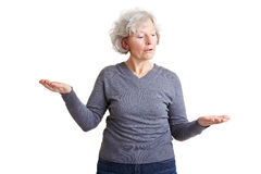 Elderly woman comparing two Royalty Free Stock Photography