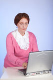 An elderly woman at the computer Royalty Free Stock Photos