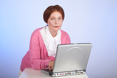 An elderly woman at the computer Stock Image