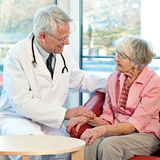 Elderly woman in consultation with her doctor. Royalty Free Stock Photography