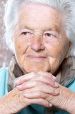 Elderly woman contemplating Royalty Free Stock Image