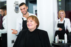 Elderly woman contented haircut Royalty Free Stock Photo
