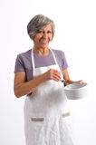 Elderly woman cook Royalty Free Stock Photos