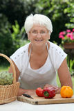Elderly woman cooking Royalty Free Stock Images