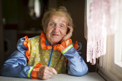 An elderly woman in Cossack clothes Stock Photos