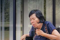 Elderly woman cough ,choke. At home royalty free stock photo