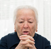 Elderly woman coughing Royalty Free Stock Image