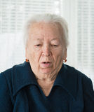 Elderly woman coughing Stock Photo