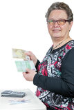 Elderly woman counting and showing money Stock Photography