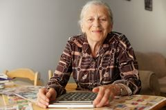 Elderly woman coupons Royalty Free Stock Photos