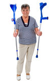Elderly woman with crutches Royalty Free Stock Image