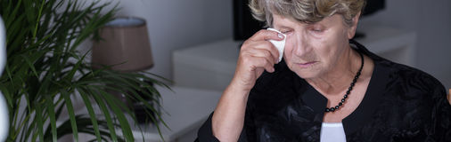 Elderly woman crying Stock Image