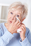Elderly woman crying. Portrait of sad elderly woman crying,vertical stock photos