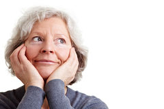 Elderly woman daydreaming Royalty Free Stock Images