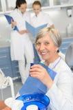 Elderly woman dentist team at dental surgery Royalty Free Stock Photos