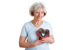 Elderly woman with different hearts Royalty Free Stock Photo