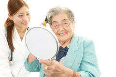 An elderly woman and a doctor Stock Photography