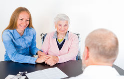 Elderly woman at the doctor Stock Photos