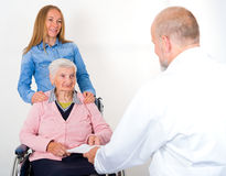 Elderly woman at the doctor Royalty Free Stock Photos