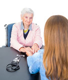 Elderly woman at the doctor Stock Image