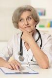 Elderly woman doctor Stock Photos