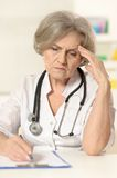 Elderly woman doctor Stock Image