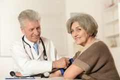 Elderly woman and doctor Stock Photos