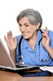Elderly woman doctor Stock Images