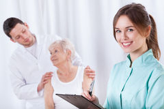 Elderly woman with doctors during rehabilitation. Elderly women with doctors during rehabilitation, horizontal Royalty Free Stock Photo