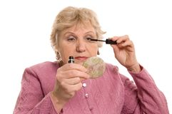 The elderly woman does a make-up Royalty Free Stock Photos