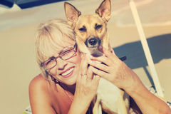 Elderly woman and dog Stock Images