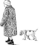 Elderly woman and dog on a walk Royalty Free Stock Photo