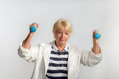 Elderly woman doing exercises with dumbbells Royalty Free Stock Photo