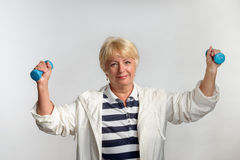 Elderly woman doing exercises with dumbbells Royalty Free Stock Image