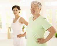 Elderly woman doing exercises with trainer Royalty Free Stock Photography