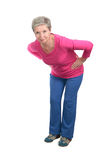 Elderly woman doing forward bends Stock Image