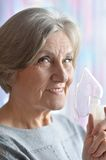 Elderly woman doing inhalation Royalty Free Stock Photography