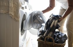 Elderly woman doing a laundry Stock Images
