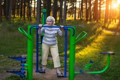 Elderly woman doing morning exercise. Stock Images