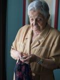 Elderly woman doing needlework Royalty Free Stock Photo