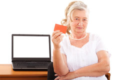 Elderly woman doing online shopping Stock Photo