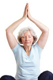 Elderly woman doing yoga stock image