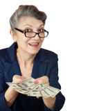 Elderly woman with dollars Stock Photos
