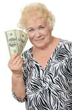 The elderly woman with dollars Royalty Free Stock Images