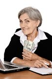 Elderly woman with dollars Stock Images
