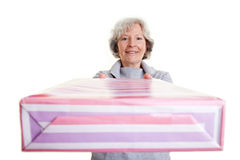 Elderly woman donating big gift Stock Photography