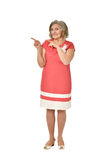 Elderly woman in dress pointing Royalty Free Stock Photos