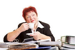 Elderly woman drinking coffee at Stock Image