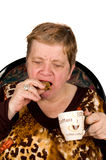 Elderly woman is drinking coffee Royalty Free Stock Photo